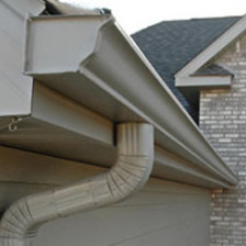 Tan colored gutter and downspout